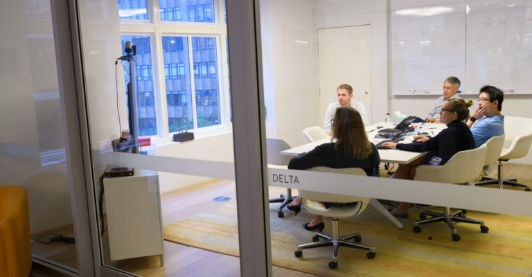 Optiver employees in a meeting