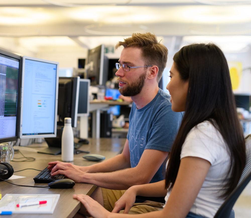 Two Optiver employees undergoing market maker training
