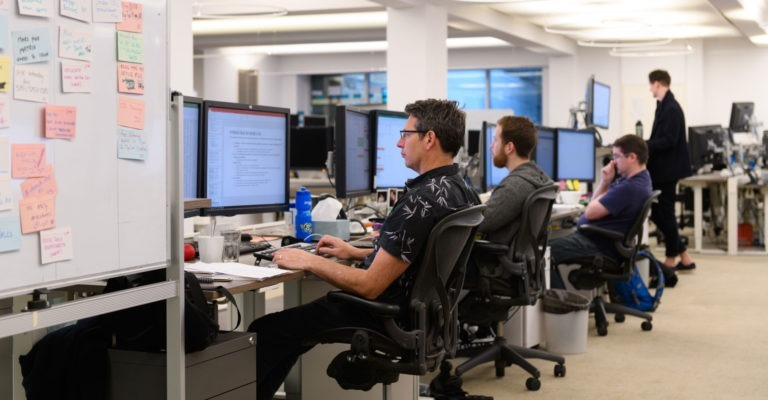 Men working at the Optiver office
